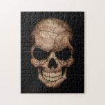 Cráneo agrietado que emerge de oscuridad puzzle con fotos