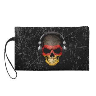 Cráneo alemán rasguñado de DJ con los auriculares