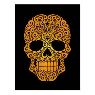 Cráneo amarillo del azúcar que remolina en negro postales