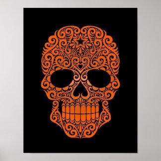 Cráneo anaranjado del azúcar que remolina en negro póster