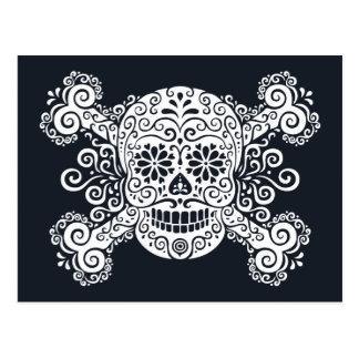 Cráneo antiguo y bandera pirata del azúcar postal