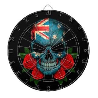 Cráneo australiano de la bandera con los rosas roj tablero dardos