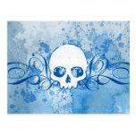 Cráneo azul con los salpicones y los remolinos postal
