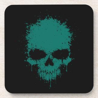 Cráneo azul de la salpicadura del goteo del trullo posavasos de bebida