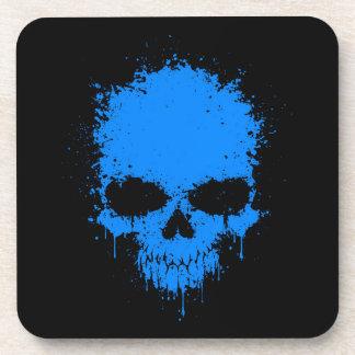Cráneo azul de la salpicadura del goteo posavasos