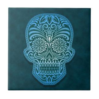 Cráneo azul decorativo del azúcar teja