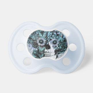 Cráneo azul del ohmio del grunge con los rosas chupetes para bebés