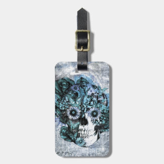 Cráneo azul del ohmio del grunge con los rosas etiquetas para equipaje