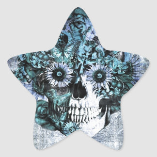 Cráneo azul del ohmio del grunge con los rosas pegatina en forma de estrella