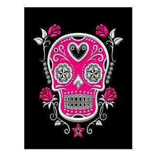 Cráneo blanco y rosado del azúcar con los rosas en postales