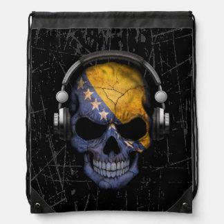 Cráneo bosnio rasguñado de DJ con los auriculares Mochila