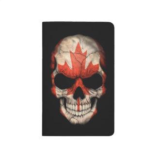 Cráneo canadiense de la bandera en negro cuaderno