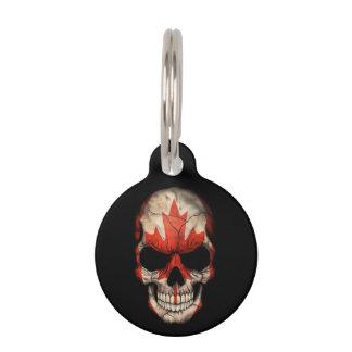Cráneo canadiense de la bandera en negro identificador para mascota