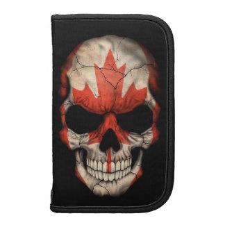 Cráneo canadiense de la bandera en negro planificadores