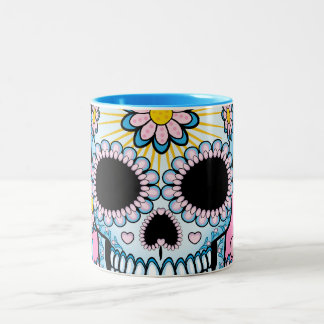 Cráneo colorido del azúcar taza de café de dos colores