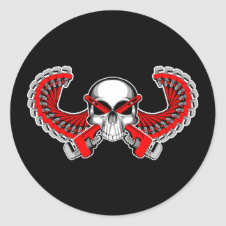 Cráneo con alas del fontanero pegatina redonda