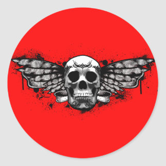 Cráneo con alas negro pegatina redonda