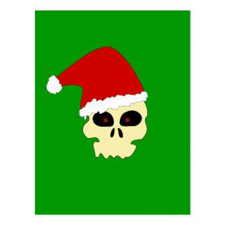 Cráneo con la postal del gorra de Santa