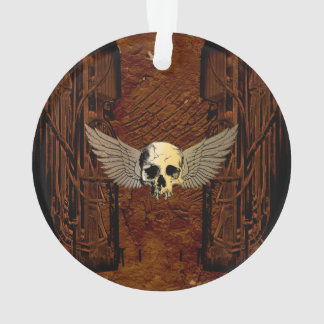 Cráneo con las alas en fondo oscuro