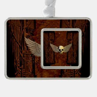 Cráneo con las alas en fondo oscuro adornos con foto