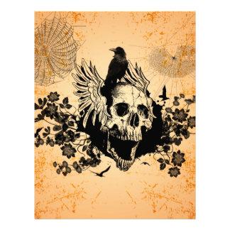 Cráneo con las alas y el cuervo con las flores plantillas de membrete