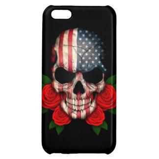 Cráneo de la bandera americana con los rosas rojos