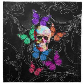 Cráneo de la fantasía y mariposas coloreadas servilletas de papel
