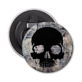 Cráneo de piedra abrebotellas redondo