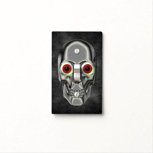 Cráneo de plata con los globos del ojo rojos tapas para interruptores