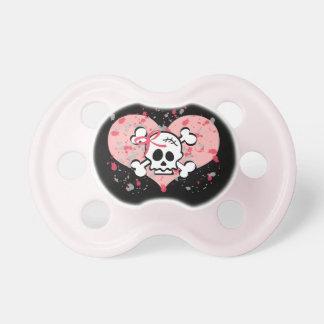 Cráneo del arco y pacificador rosados de la bander chupete de bebé
