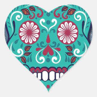 Cráneo del azúcar de la turquesa en un fondo calcomanías corazones