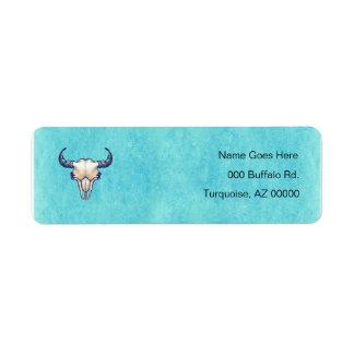 Cráneo del bisonte en la turquesa etiqueta de remite
