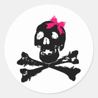 Cráneo del chica con el arco rosado etiquetas