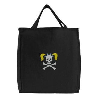 Cráneo del chica con el bolso bordado coletas bolsas de lienzo