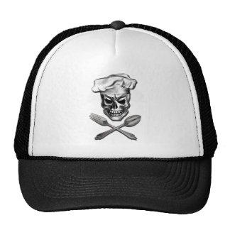 Cráneo del cocinero con la bifurcación y la gorras de camionero