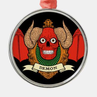 Cráneo del diablo del demonio con las alas del adorno navideño redondo de metal