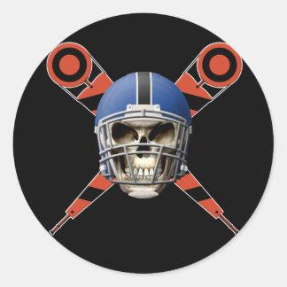 Cráneo del fútbol con los marcadores del casco y etiqueta redonda