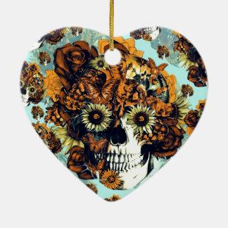Cráneo del girasol en azul y anaranjado adorno navideño de cerámica en forma de corazón