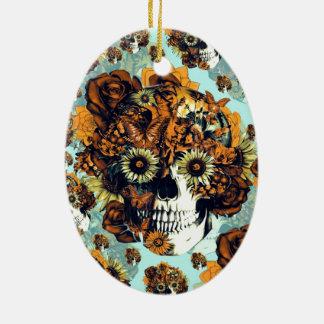 Cráneo del girasol en azul y anaranjado adorno navideño ovalado de cerámica