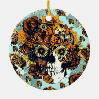 Cráneo del girasol en azul y anaranjado adorno navideño redondo de cerámica