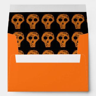 Cráneo del naranja de Halloween Sobre