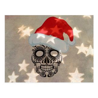 Cráneo del navidad con el bokeh de la estrella postal