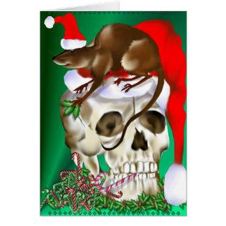 Cráneo del navidad y tarjeta feliz de la rata