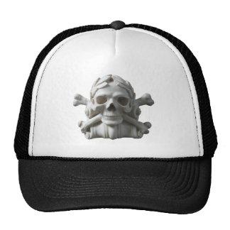 Cráneo del pirata y casquillo esqueléticos de los  gorras