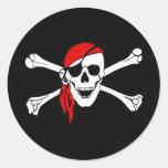 Cráneo del pirata y pegatina de la bandera pirata