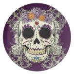 Cráneo del vintage y placa de las flores platos