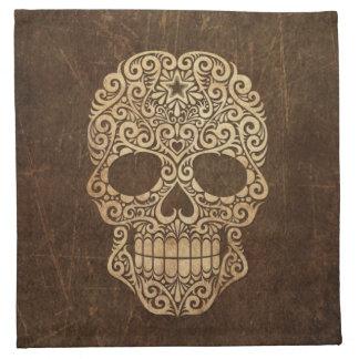Cráneo envejecido y rasguñado del azúcar que remol servilletas imprimidas