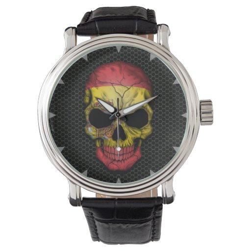 Cráneo español de la bandera en el gráfico de relojes de mano