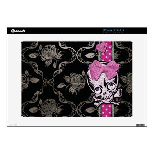 Cráneo espeluznante del chica con el arco rosado e skins para portátil