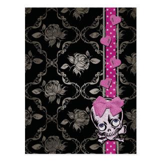 Cráneo espeluznante del chica con el arco rosado e tarjeta postal